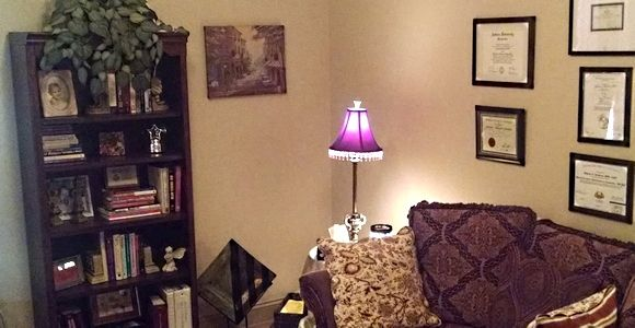 Anxiety Relief Montgomery, AL - Healing Hearts Counseling therapy room with couch and ambient lighting